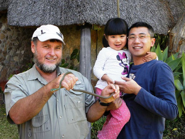 Chinese doll (and Dad) meets Mr. Bushsnake